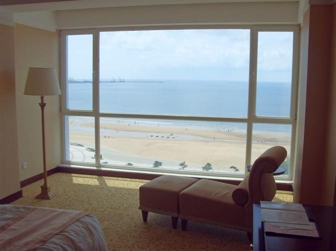 烟台海阳市黄金海岸大酒店 一线海景房预订 豪华套房定金